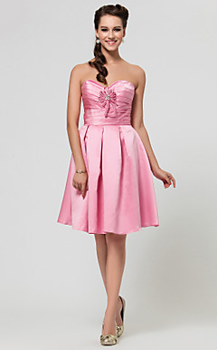 A-line Sweetheart Knee-length Satin Bridesmaid Dress With Criss Cross